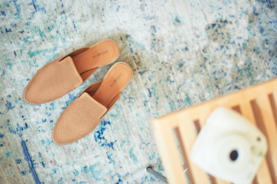 Birds eye view of tan slides on blue and white carpet.