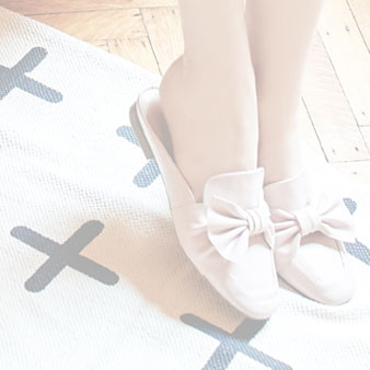 Light pink flats with bow on them.
