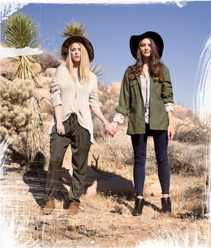 Two girls in the desert wearing boots.