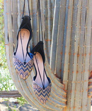 Gabbie sandals hanging from cactus.
