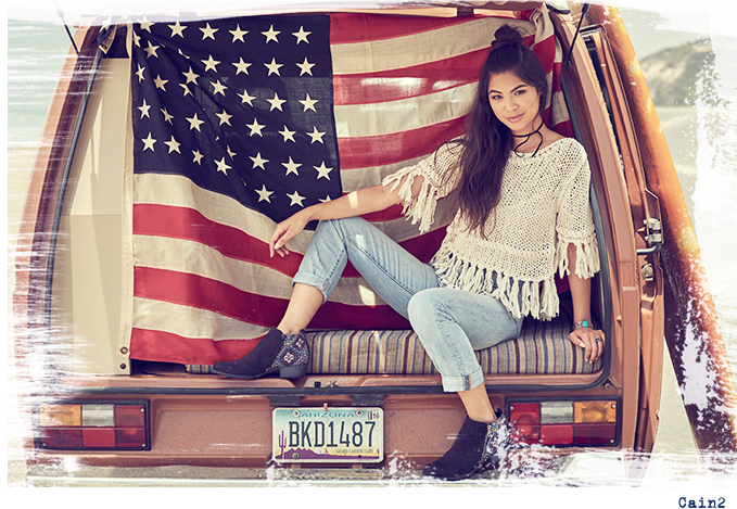Girl in back of van wearing Cane2's with America flag back drop.
